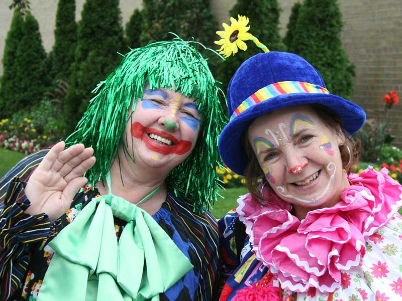 Be-Bop and Sookie the Clown are hamming it up for the Cameras